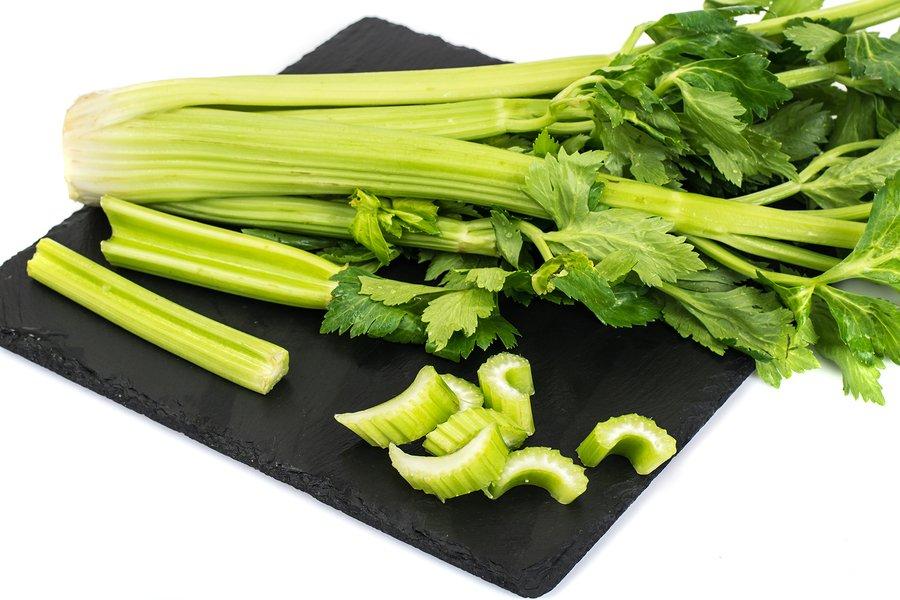 cutting celery for juice